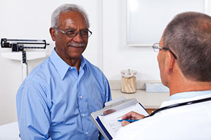 Patient discussing risk factors of esophageal cancer with a physician