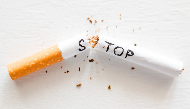 Broken Cigarette With The Word Stop Stop Smoking Concept Closeup Picture Id1052047866