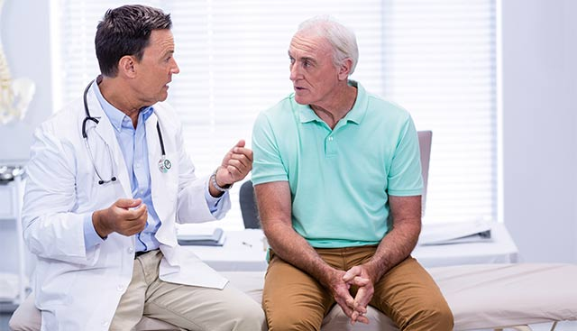 Doctor talking with a male patient about leukemia