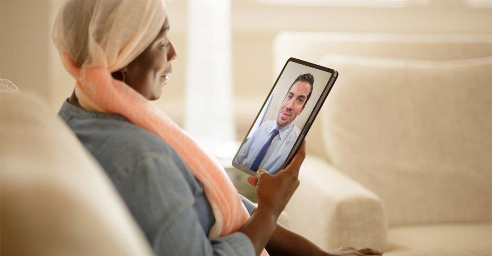 Woman With Cancer having a Virtual Visit with Doctor