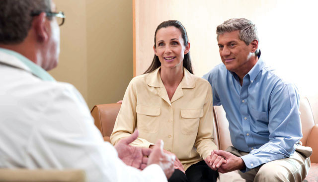 patients speakign with doctor while sitting on couch