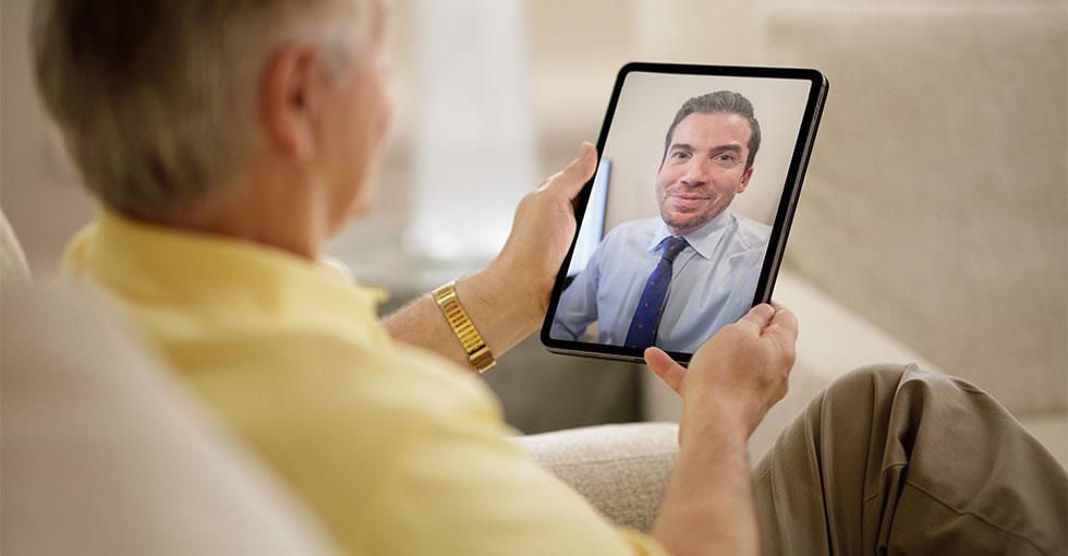 Man speaking with Moffitt doctor during virtual visit