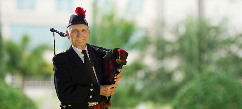 Stanley Carr began playing the bagpipes at age 12