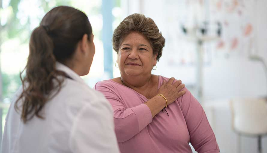 Woman speaking with lung cancer doctor