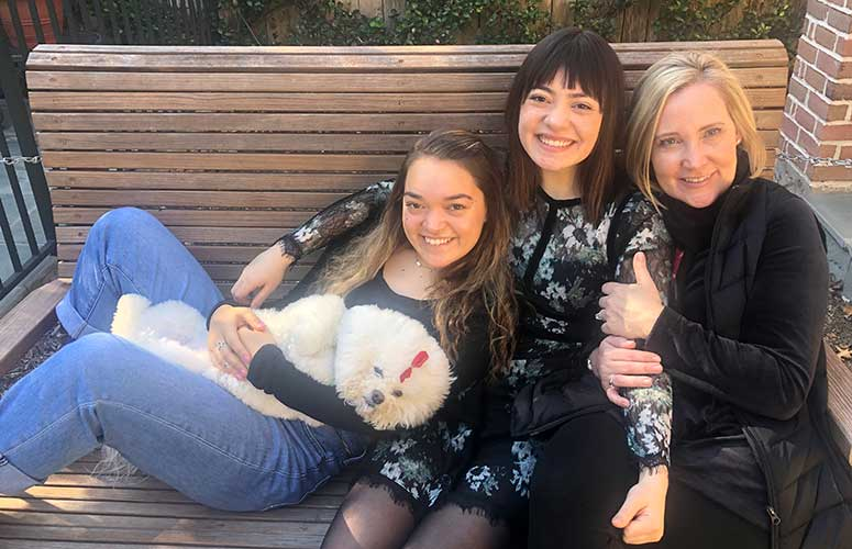From left: Hwu's daughters, Ally and Emily, wife Katie, and family dog, Maisy.