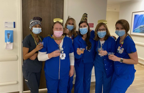 Rau with her nurse colleagues at Moffitt.