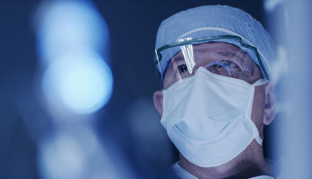 Head and neck cancer doctor performing surgery