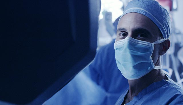 lung cancer surgeon looking into camera
