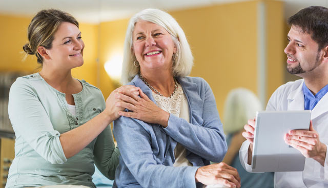 Mother and daughter discussing uterine cancer with a healthcare provider