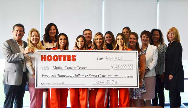 Hooters presents check to Moffitt