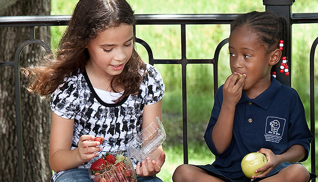 Kids eating healthy fruit