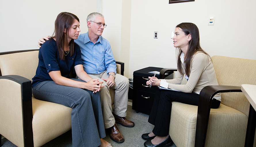 Social workers talking to Moffitt patient