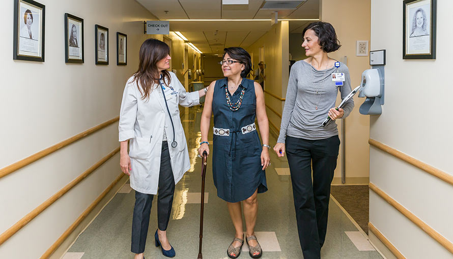 Certified interpreters at Moffitt speak with a patient